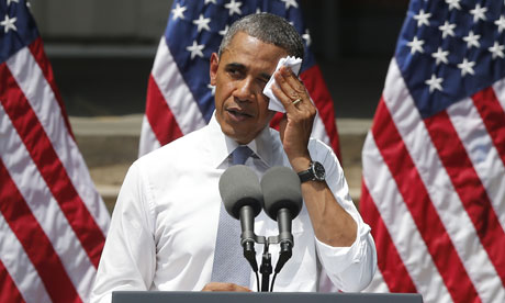 President Barack Obama wipes perspiration from his face as he speaks about climate change in Washington. Photograph: Charles Dharapak/AP